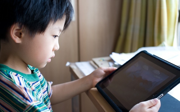 Child and iPad