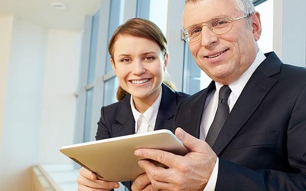 Senior business leader with happy businesswomen on background
