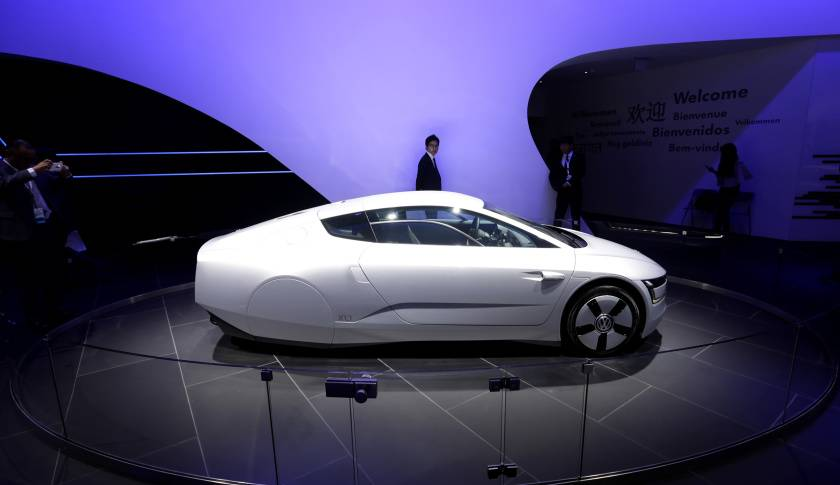 A Volkswagen XL1 hybrid car is displayed at Auto China 2014 in Beijing