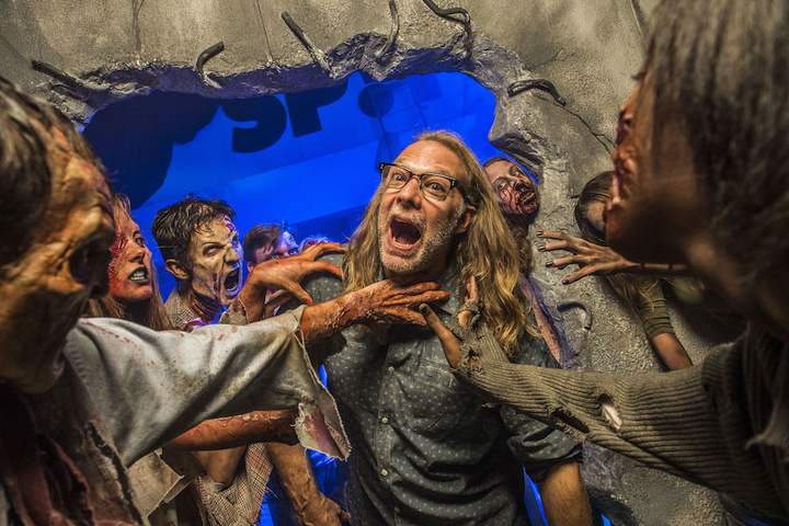 Greg Nicotero, Co-Executive Producer and Director of Special Effects Make-Up Artist for AMC's The Walking Dead, found himself surrounded by a horde of walkers at Universal Orlando's Halloween Horror Nights 24. During his visit to the event on October 25, Nicotero experienced the real-life terror of his own undead creations inside AMC's The Walking Dead: End of the Line haunted house.   The Walking Dead: End of the Line – the biggest house in Halloween Horror Nights history featuring the largest cast of scareactors –  is one of this year's most popular haunted houses, surpassing guest ratings from both 2013's and 2012's incredibly popular experiences based on the hit television show.    Universal's Halloween Horror Nights 24 runs on select nights now through November 1. For more information, visit:  HalloweenHorrorNights.com/Orlando.
