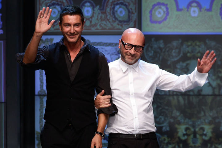 MILAN, ITALY - SEPTEMBER 22:  Designers Stefano Gabbana (L) and Domenico Dolce acknowledge the audience at the end of the last D&G fashion show as part of Milan Fashion Week Womenswear Spring/Summer 2012 on September 22, 2011 in Milan, Italy.  (Photo by Vittorio Zunino Celotto/Getty Images)