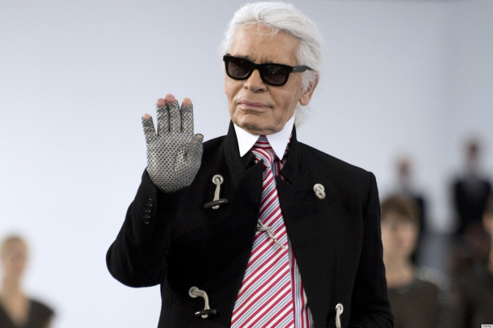 German fashion designer Karl Lagerfeld for Chanel acknowledges the public at the end of  the Spring/Summer 2013 ready-to-wear collection show on October 2, 2012 at the Grand Palais in Paris. AFP PHOTO/MARTIN BUREAU        (Photo credit should read MARTIN BUREAU/AFP/GettyImages)
