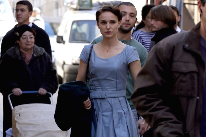 """Oscar winning star Natalie Portman acts in a scene of a new film she is directing herself on February 13, 2014 in Jerusalem. Portman is in the city to work on a film adapted from Israeli novelist Amos Oz's acclaimed memoir """"A Tale of Love and Darkness"""", which has been translated into 28 languages and has sold over a million copies worldwide. The film details Oz's childhood in Jerusalem in the chaotic period at the end of the British mandate in Palestine, as well as the writer's experiences during the early years following the establishment of the the state of Israel and his teenage in a kibbutz. Portman, who was born in Jerusalem to an Israeli father and an American mother, plays a supporting role as Oz's mother. AFP PHOTO/GALI TIBBON"""