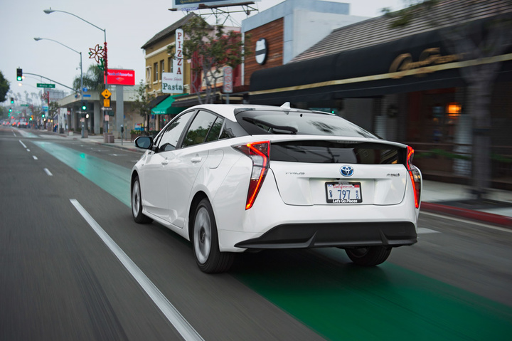 2016-Toyota-Prius-Four-Touring-rear-three-quarter-in-motion