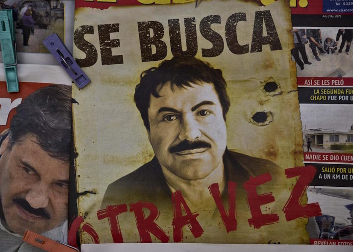 480596528-poster-with-the-face-of-mexican-drug-lord-joaquin-el.jpg.CROP.promo-xlarge2