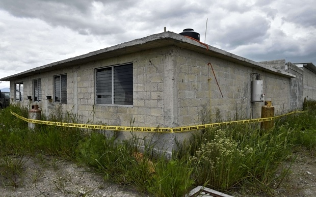 "Picture of the yellow tape put by security forces of the Office of the Attorney General around the house at the end of the tunnel through which Mexican drug lord Joaquin ""El Chapo"" Guzman could have escaped from the Altiplano prison, in Almoloya de Juarez, Mexico, on July 12, 2015. Guzman has escaped from a maximum-security prison, the government said Sunday, his second jail break in 14 years. The kingpin was last seen in the shower area of the Altiplano prison in central Mexico late Saturday before disappearing. ""The escape of Guzman was confirmed"", the National Security Commission said in a statement.  AFP PHOTO / YURI CORTEZYURI CORTEZ/AFP/Getty Images"