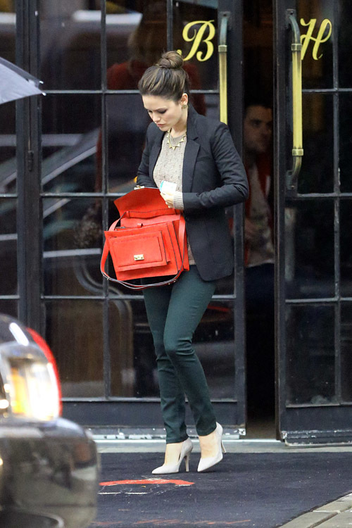 Rachel Bilson was spotted leaving her New York City hotel on a rainy day. Pictured: Rachel Bilson Ref: SPL443440  031012   Picture by: Sharpshooter Images /Splash Splash News and Pictures Los Angeles:	310-821-2666 New York:	212-619-2666 London:	870-934-2666 photodesk@splashnews.com