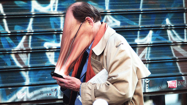 3053505-poster-p-1-eerie-photo-essay-shows-peoples-faces-getting-warped-by-their-devices