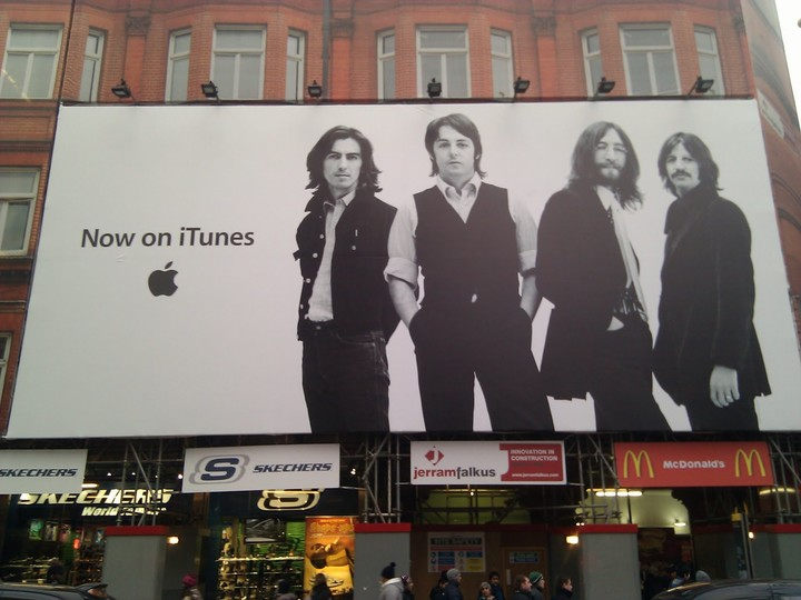 Beatles on itunes Oxford Street poster