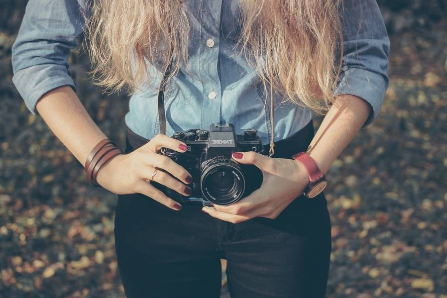 person-woman-camera-taking-photo-large
