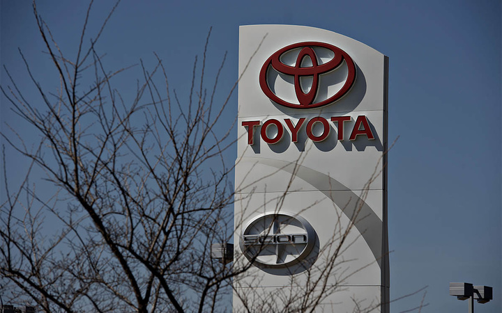 A sign stands outside Hiland Toyota dealership in Moline, Illinois, U.S., on Wednesday, April 9, 2014. Toyota Motor Corp., the world's largest carmaker, called back more than 6 million vehicles to fix a range of safety defects in one of the biggest recalls in automotive history. Photographer: Daniel Acker/Bloomberg