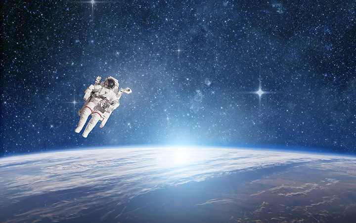 Astronaut in outer space against the planet earth. Elements of this image furnished by NASA.