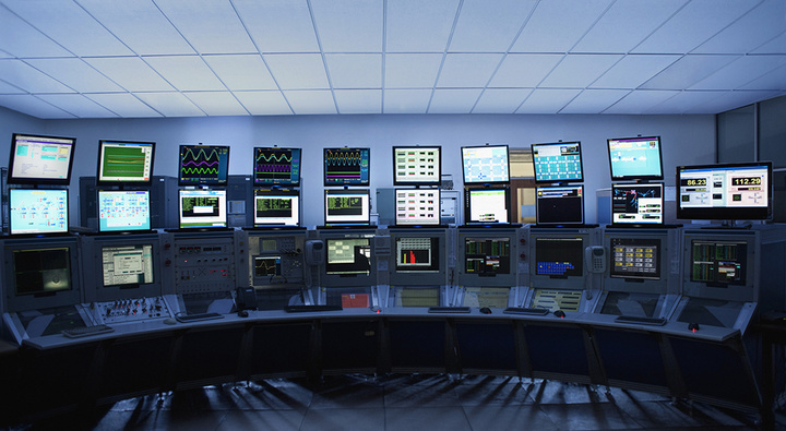 Computer screens in control room