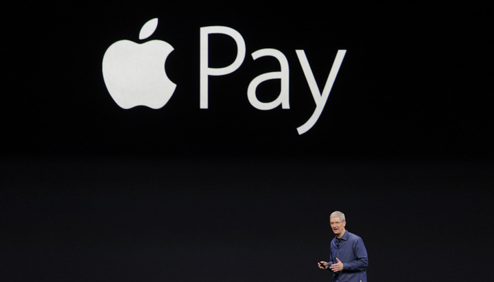 Tim Cook, chief executive officer of Apple Inc., unveils Apple Pay during a product announcement at Flint Center in Cupertino, California, U.S., on Tuesday, Sept. 9, 2014. Apple Inc. unveiled redesigned iPhones with bigger screens, overhauling its top-selling product in an event that gives the clearest sign yet of the company's product direction under Cook. Photographer: David Paul Morris/Bloomberg via Getty Images