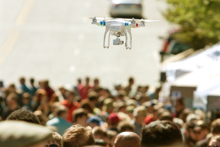 flying-drone-hovers-over-crowd-at-fair-640x0