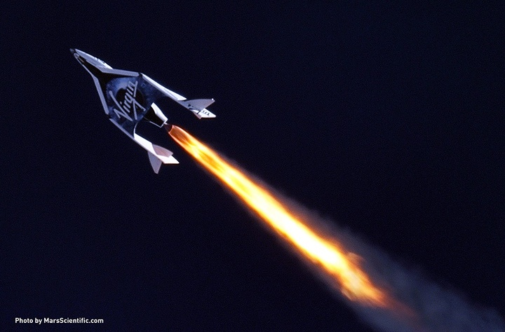 """Virgin Galactic's SpaceShip2 under rocket power, its first ever since the program began in 2005. The spacecraft was dropped from its """"mothership"""", WhiteKnight2 over the Mojave, CA area, April 29, 2013 at high altitude before firing its hybrid power motor. Virgin Galactic hopes to become the first commercial space venture to bring multiple passengers into space on a regular basis."""
