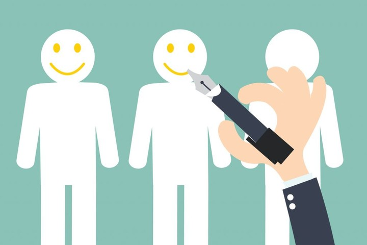 Hand writing Smiley on the Customer - Customer Retention